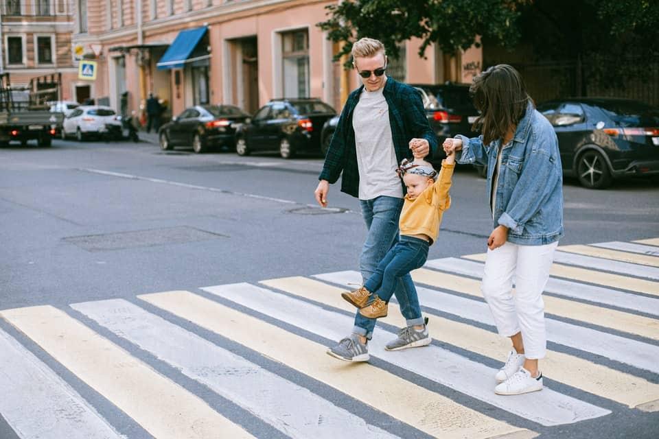 family crossing street